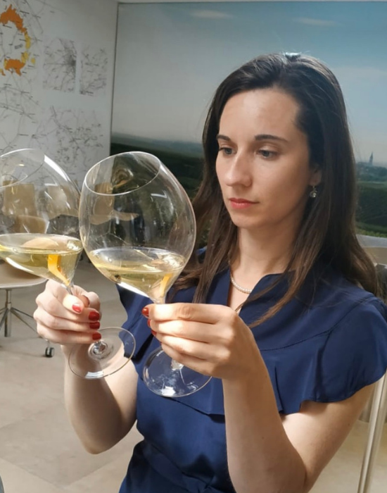Emily curating two different wines