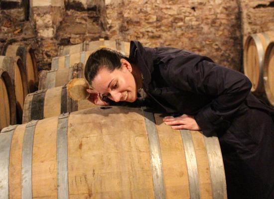 Emily at a wine cellar tour.