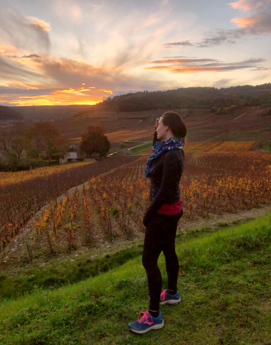 Emily enjoying the sunset at a vineyard.