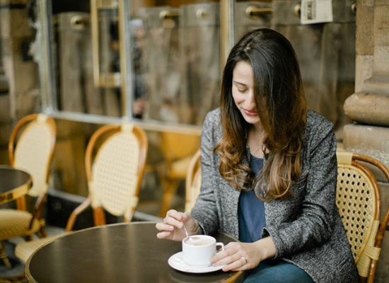 Lindsey enjoying a cup of coffee