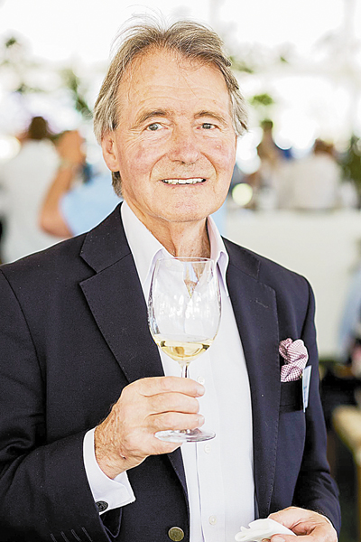 Steven Spurrier with a glass of wine.