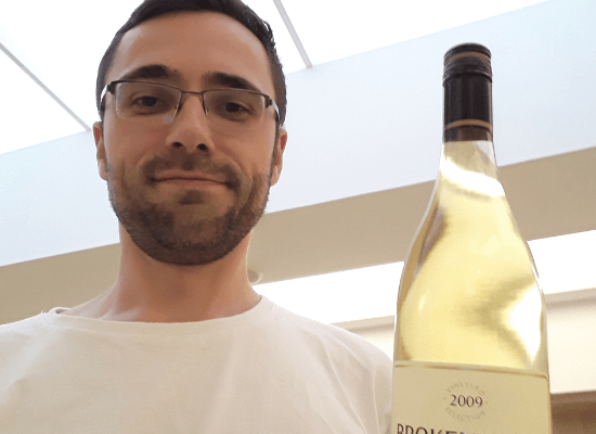 Nicolas with a bottle of fine wine.